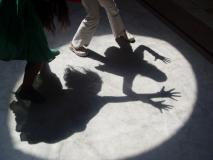Children making shadow shapes